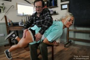 nurse in uniform is spanked OTK